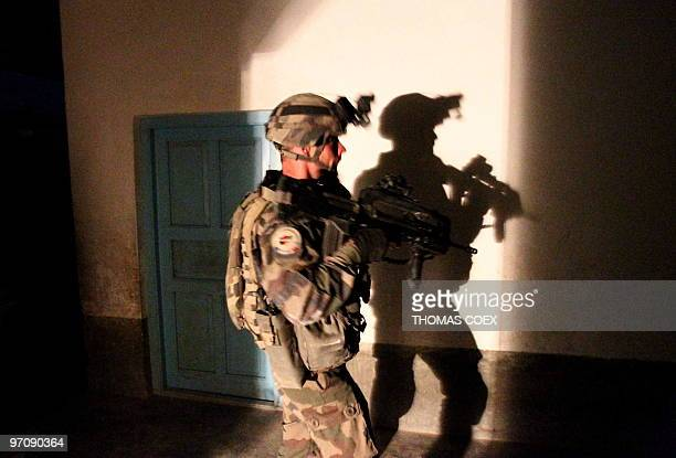 A French soldier of the 21st RIMA secures the FrenchBritish base after a RPG attack during the night in Showal Southern Afghanistan in the Helmand...