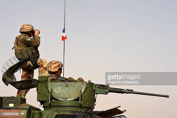 A French soldier of the 93rd Mountain Artillery Regiment part of the French Army's Operation Barkhane an antiterrorist operation in the Sahel looks...