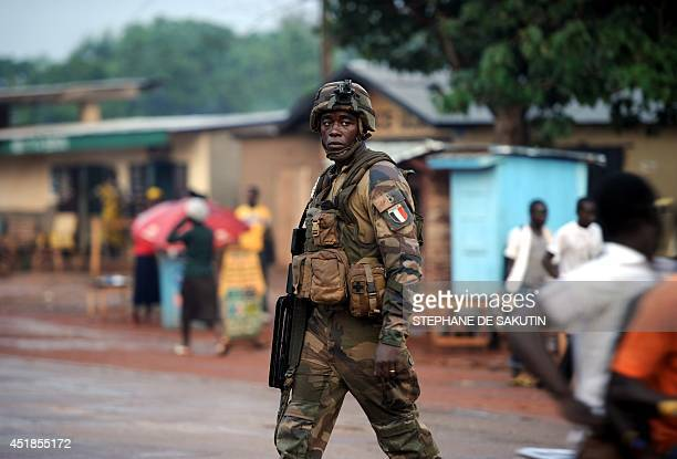 A French soldier of the European Union's military force patrols on July 7 2014 through a street of Bangui French Defence minister JeanYves Le Drian...