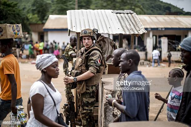 A French soldier of the Sangaris contingent mans a checkpoint in the formerly Muslim PK12 district of Bangui on June 4 2014 France sent troops six...