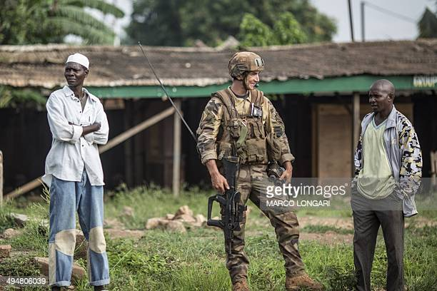 A French soldier of the Sangaris contingent patrols the 'Muslim enclave' of the PK 5 district of Bangui on May 31 2014 Three people were killed in...