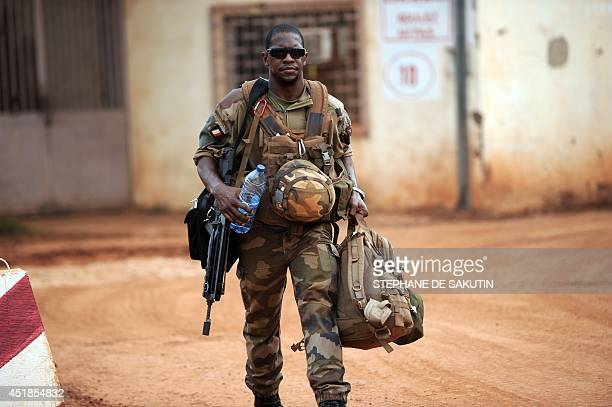 A French soldier of the Sangaris force walks through the French military base of Bangui following his return from the Bambari region on July 7 2014...