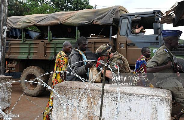 A French soldier of the Sangaris military operation searches a man's bag at the PK12 checkpoint on March 1 2014 in Bangui French President Francois...