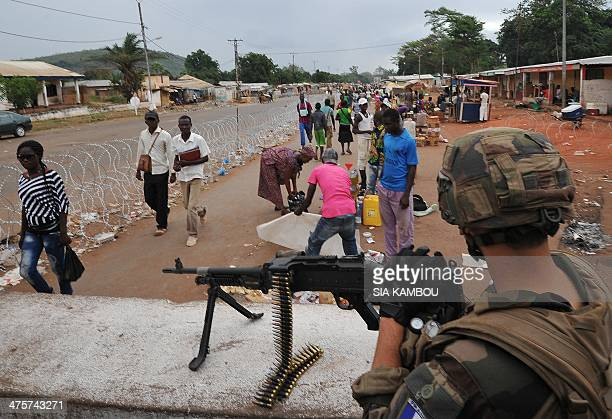A French soldier of the Sangaris military operation takes position at the PK12 checkpoint on March 1 2014 in Bangui French President Francois...