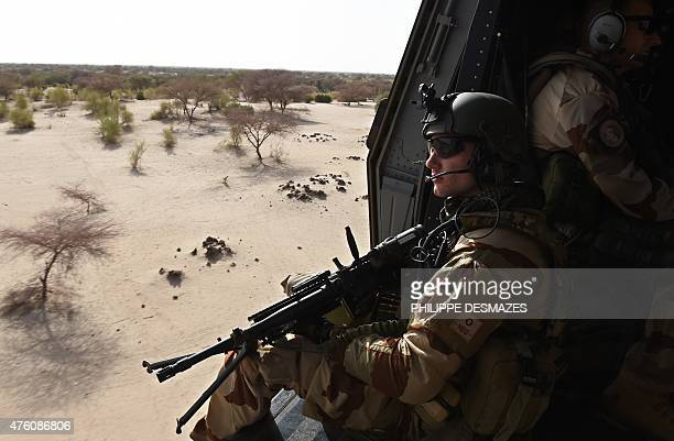 A French soldier overflies the desert on the French army helicopter NH 90 'Caïman' on June 1 2015 near Gao during the Operation Barkhane an...