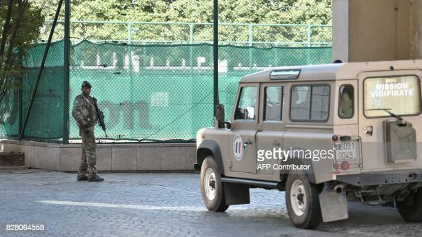 A French soldier part of Operation Sentinelle patrols near the site where a car slammed into soldiers on patrol in LevalloisPerret outside Paris on...