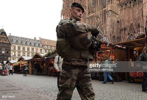 A French soldier patrols in the Christmas market area near the Cathedral in Strasbourg eastern France on November 25 on its opening day For security...