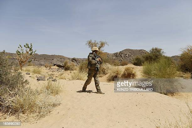 A French soldier patrols on March 16 in Adrar des Ifoghas mountains in northern Mali AFP PHOTO / KENZO TRIBOUILLARD