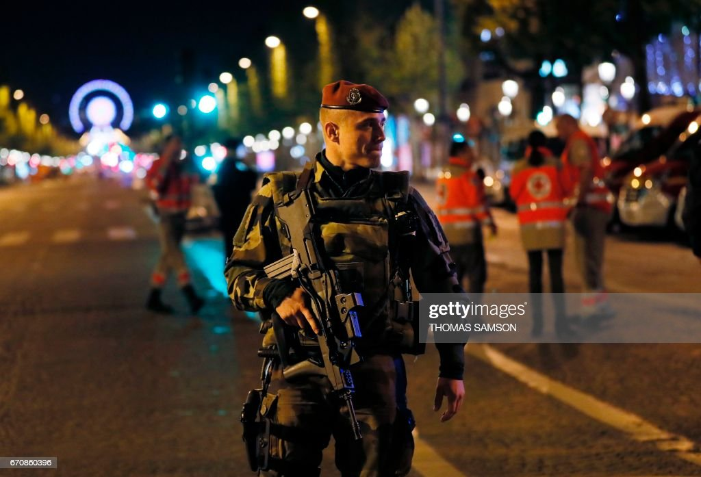 French soldier patrols on the Champs Elysees in Paris after a shooting on April 20, 2017. One police officer was killed and another wounded today in a shooting on Paris's Champs Elysees, police said just days ahead of France's presidential election. France's interior ministry said the attacker was killed in the incident on the world famous boulevard that is popular with tourists. /