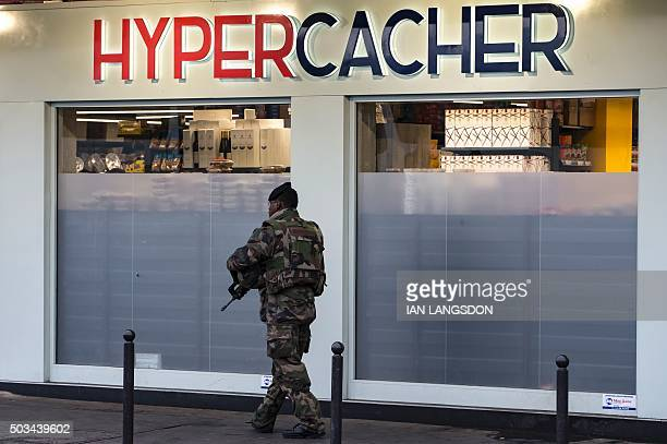 A French soldier patrols outside the Hyper Cacher a kosher supermarket near Paris on January 5 after France's President attended a commemorative...