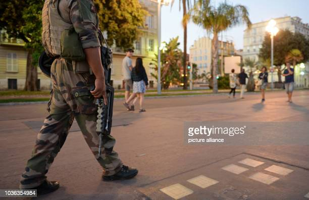 A French soldier patrols the Promenade des Anglais near the scene in Nice France July 16 2016 where a truck drove into a crowd during Bastille Day...