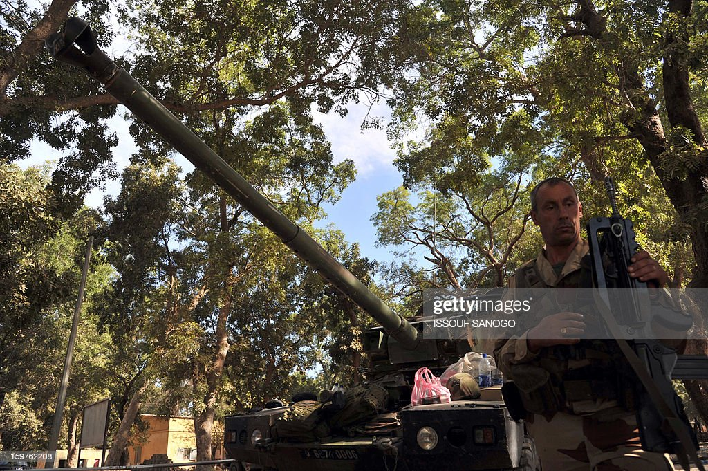 A French soldier prepares a tank on January 20, 2013 in the city of Niono, about 350 kms (220 miles) northeast of the capital Bamako and 60 kms south of Diabaly, which was seized on January 14 by Islamists and then heavily bombed by French warplanes. A spokesman for the French military operation codenamed Serval said on January 20 that French forces were advancing towards Mali's Islamist-held north after taking up positions in the towns of Niono and Sevare. SANOGO