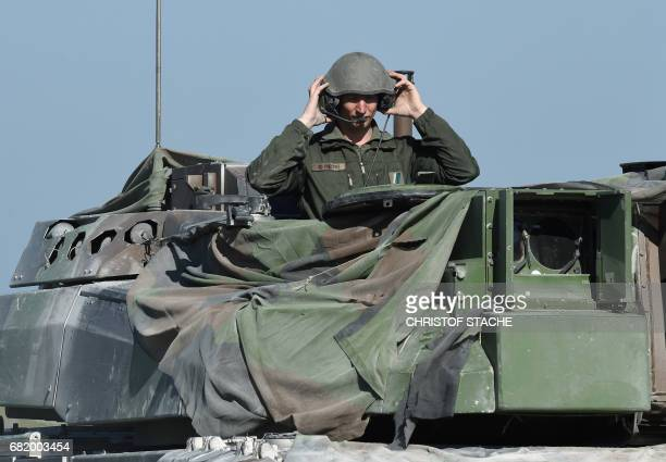 French soldier puts on his helmet at a tank type 'Leclerc' during a break of the exercise 'Strong Europe Tank Challenge 2017' at the exercise area in...