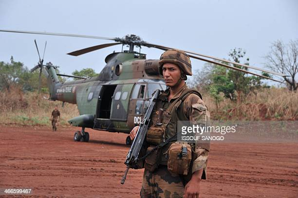 A French soldier stands guard in front of a helicopter transporting French army general Francesco Soriano the commander of the Frenchled 'Operation...