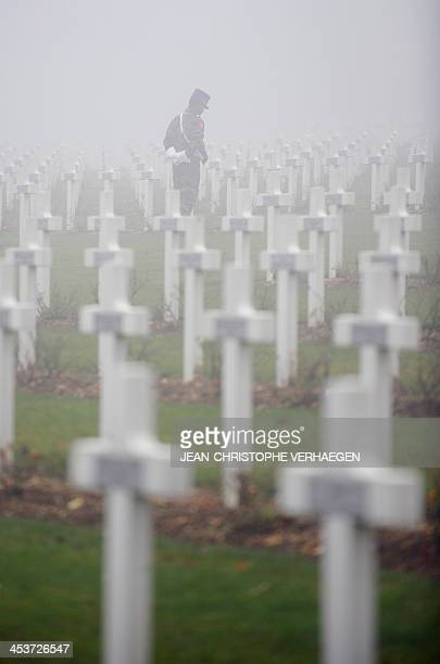 A French soldier stands in the Douaumont ossuary 'national necropolis' in Douaumont on December 5 after the burial of 24 French soldiers who died...