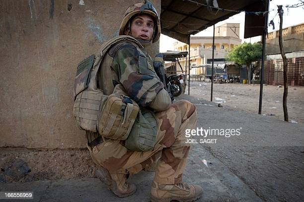 A French soldier takes position during a false alert by the population signaling the presence of MUJAO members in a street in Gao on April 13 2013...