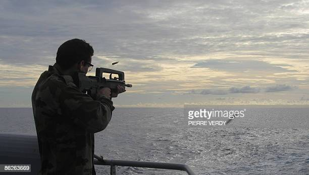 A French soldier trains on the deck of the French warship 'Nivose' on April 28 two days after leaving the Mombasa harbour in Kenya The ship in bound...