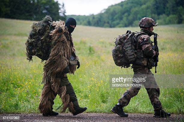 A French soldier wearing camouflage walks behing another during a FrenchUS Royal Blackhawk military exercise with French US Dutch British and Belgian...