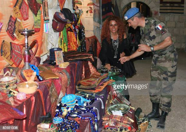 A French soldier with the UN Interim Force in Lebanon visits an artisan products exhibition held in the southern Lebanese village of Tibnin near the...
