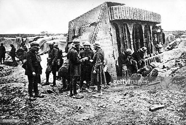French soldiers around a toppled German A7V tank near VillersBretonneux