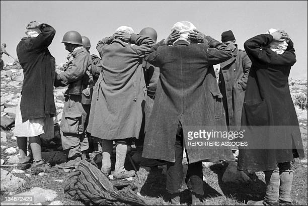 French soldiers arrest civilians during 'Operation Bigeard' in March 1956 when an armed outbreak in SoukAhras South of Constantine region Algeria led...