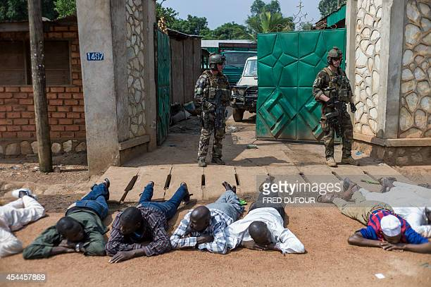 French soldiers arrest exseleka rebels after finding weapons in a house in Combattant neighborhood near Bangui's airport on December 9 2013 French...