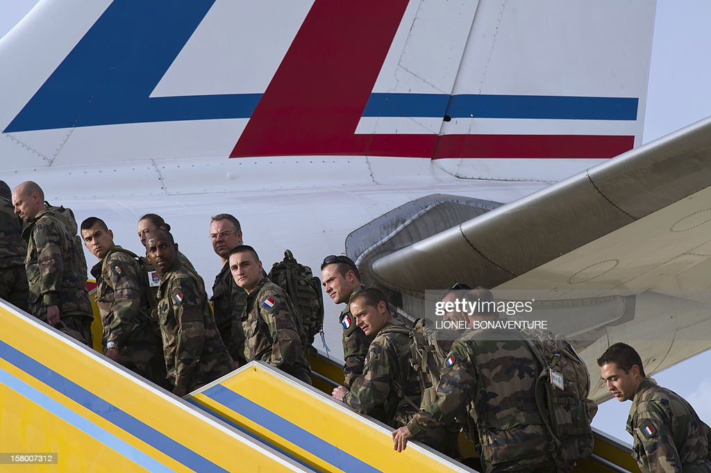 French soldiers board a plane at Paphos airport in Cyprus in December 8, 2012 before leaving for France. French Defence Minister, Jean-Yves Le Drian today welcomed some 150 French soldiers returning from Afghanistan.