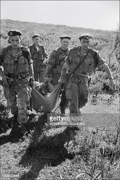French soldiers carrying a dead body during 'Operation Bigeard' in March 1956 when an armed outbreak in SoukAhras South of Constantine region Algeria...