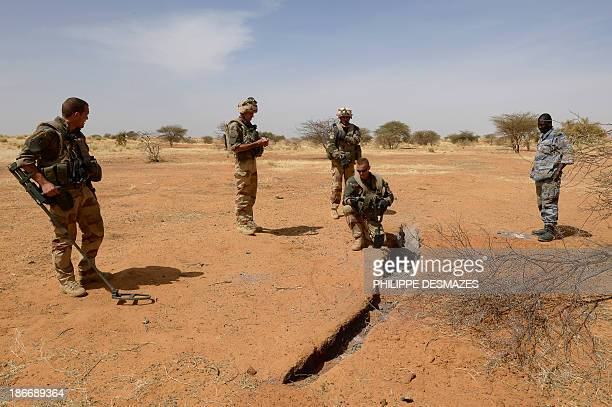 French soldiers check a site which could have been used to launch rockets towards Gao on November 2 during Operation Hydra near Gao in northern Mali...