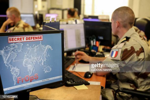 French soldiers coordinate military operations from the monitoring room of the Armed Forces Joint Operational Center on December 22 in N'Djamena