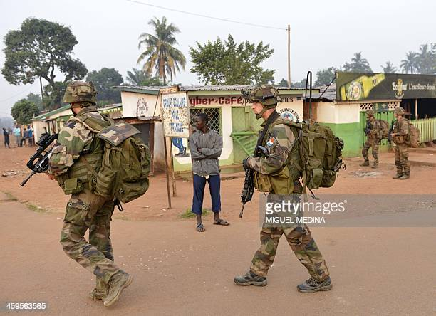"French soldiers from the 1st Parachute Infantry Regiment ,"" part of the Sangaris operation, patrol the Fouh district in Bangui on December 28, 2013...."