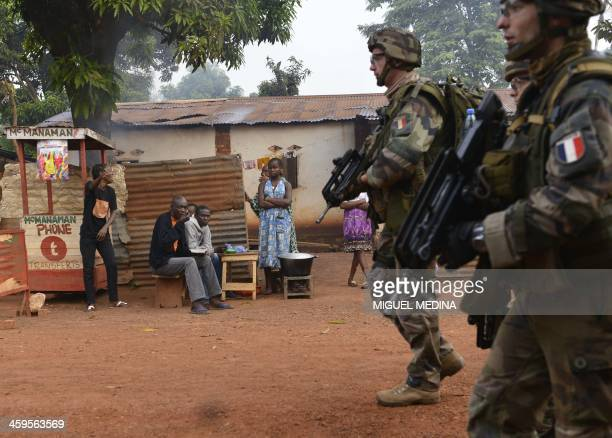 French soldiers from the 1st Parachute Infantry Regiment 1er Regiment Chasseurs Parachutistes part of the Sangaris operation patrol the Fouh district...