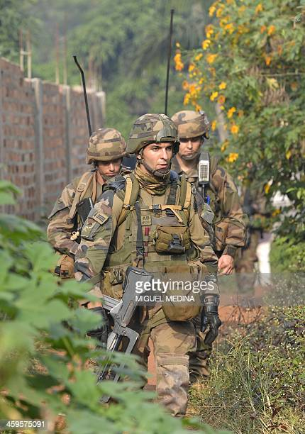 French soldiers from the 1st Parachute Infantry Regiment , part of the Sangaris operation, patrol the Fouh district in Bangui on December 28, 2013....