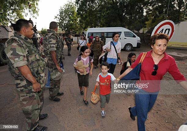 French soldiers from the 21st Marine Infantry Regiment based in Frejus view foreign families leaving on February 2008 during the evacuation...