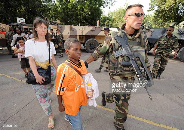 French soldiers from the 21st Marine Infantry Regiment helps foreign residents to evacuate in the Chadian capital N'Djamena on February 2008...