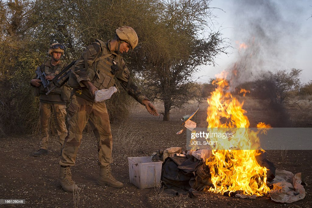 French soldiers from the 92nd Regiment Infantery burn items allegedly belonging to Mujao forces on April 8, 2013 during a military operation some 105 kilometers North of Gao. A French force of 1,000 soldiers in a major offensive has swept a valley thought to be a logistics base for Al-Qaeda-linked Islamists near the Malian city of Gao. Operation Gustav, one of France's largest actions since its intervention against insurgents in January, will involve dozens of tanks, helicopters, drones and airplanes, said General Bernard Barrera, commander of the French land forces in Mali. France is to start withdrawing its 4,000 troops from Mali at the end of April, and plans to leave a 'support force' of 1,000 soldiers after elections promised for July.