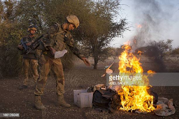 French soldiers from the 92nd Regiment Infantery burn items allegedly belonging to Mujao forces on April 8 2013 during a military operation some 105...