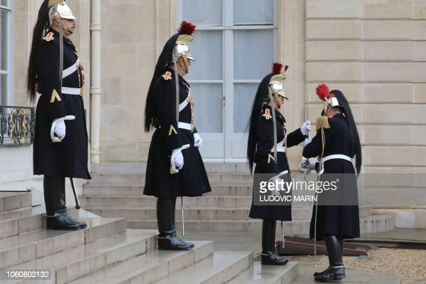 French soldiers from the cavalery republican guard of honor prepares for the arrival of the Ivory coast president at the Elysee palace on November 12...