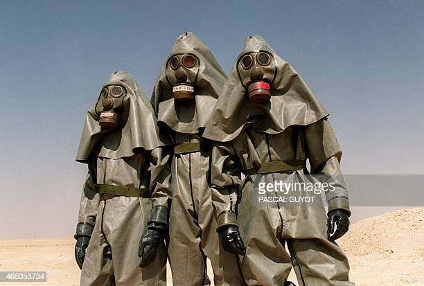 French soldiers from the Foreign Legion Infantry regiment wear 26 October 1990 in the Saudi desert near Hafr alBaten full chemical warfare equipment...