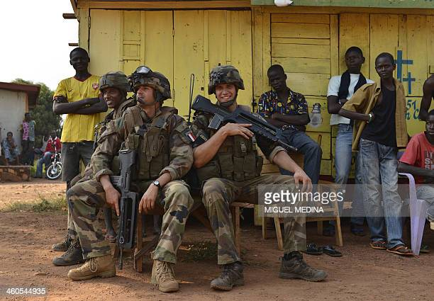 French soldiers from the Sangaris operation take a rest during a patrol at the Castor district of Bangui on January 4 2014 The Central African...