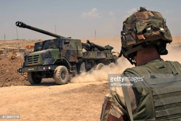 A French soldiers from the Wagram Task Force stands next to a unit of CAESAR a French selfpropelled 155 mm howitzer north of Mosul on July 13 as the...