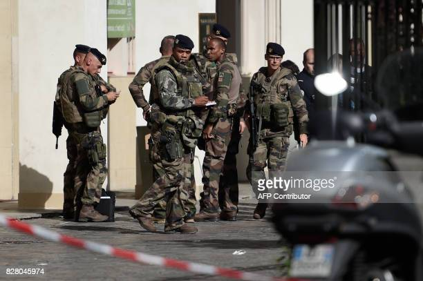 French soldiers gather at the site where a car slammed into soldiers on patrol in LevalloisPerret outside Paris on August 9 2017 A car slammed into...