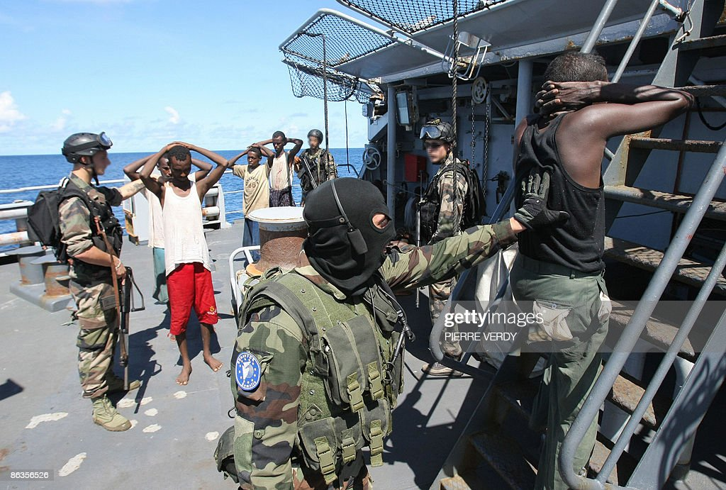French soldiers guard suspected Somali p : News Photo