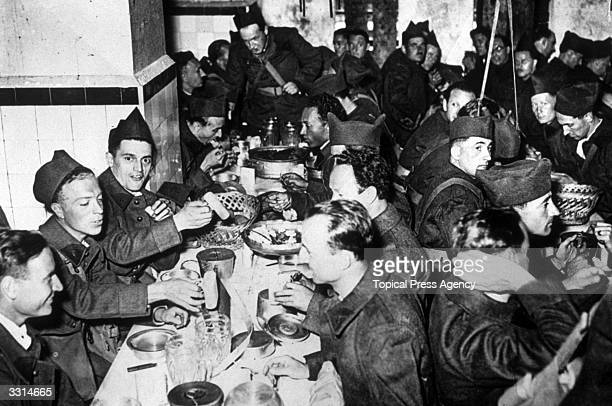 French soldiers having their first meal at a barracks in Paris