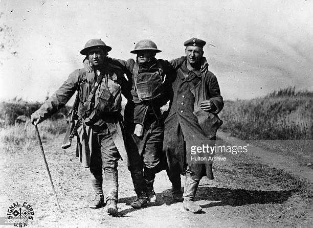 French soldiers helping a wounded comrade