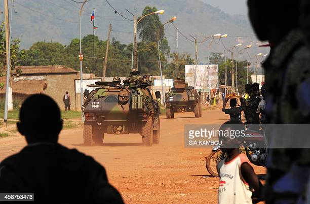 French soldiers in armoured vehicles leave the airport of Bangui to patrol the streets of the city on December 15 as part of operation Sangaris....