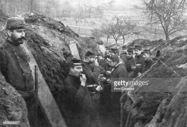 French soldiers in the trenches eating their rations France 1915