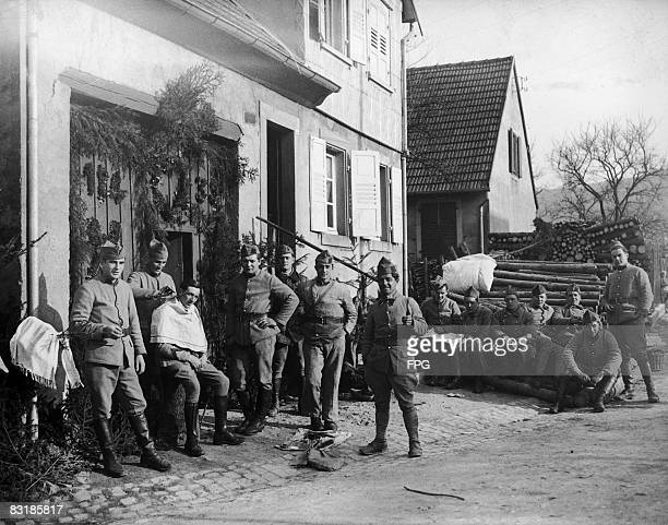 French soldiers in the village of Urmatt on the Maginot Line near Strasbourg 15th March 1936 The regimental barber can be seen at work on the left