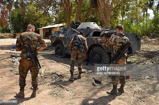 French soldiers inspect a Malian armoured vehicle on January 23 2013 in the Malian barracks that was occupied by Islamists in Diabaly before a French...