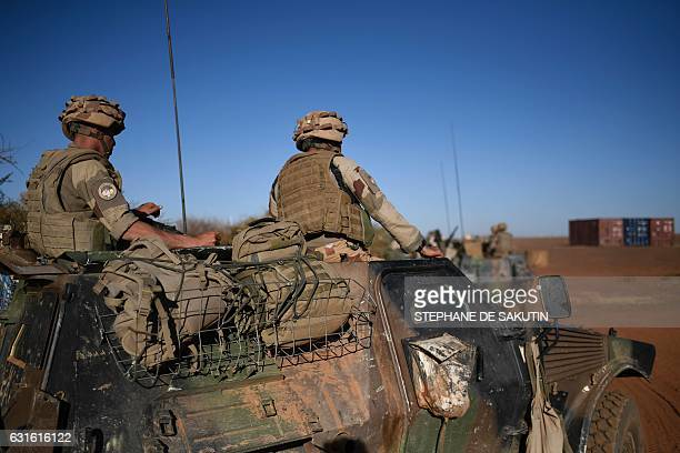 French soldiers involved in the regional antiinsurgent Operation Barkhane sit on a vehicle during the visit of the French Presidentin Africa's Sahel...